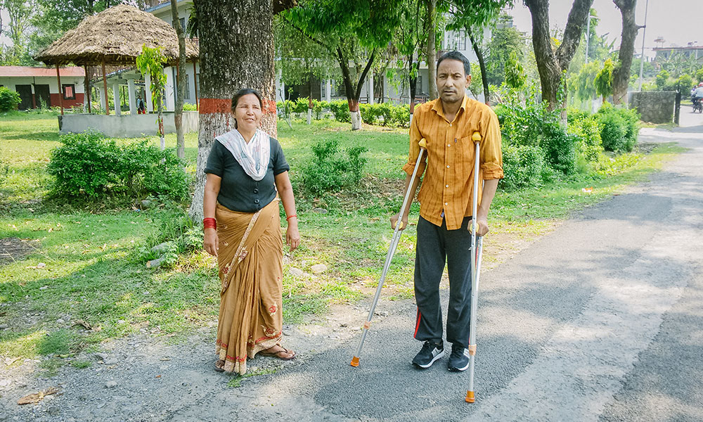Khagendra practicing walking with his wife