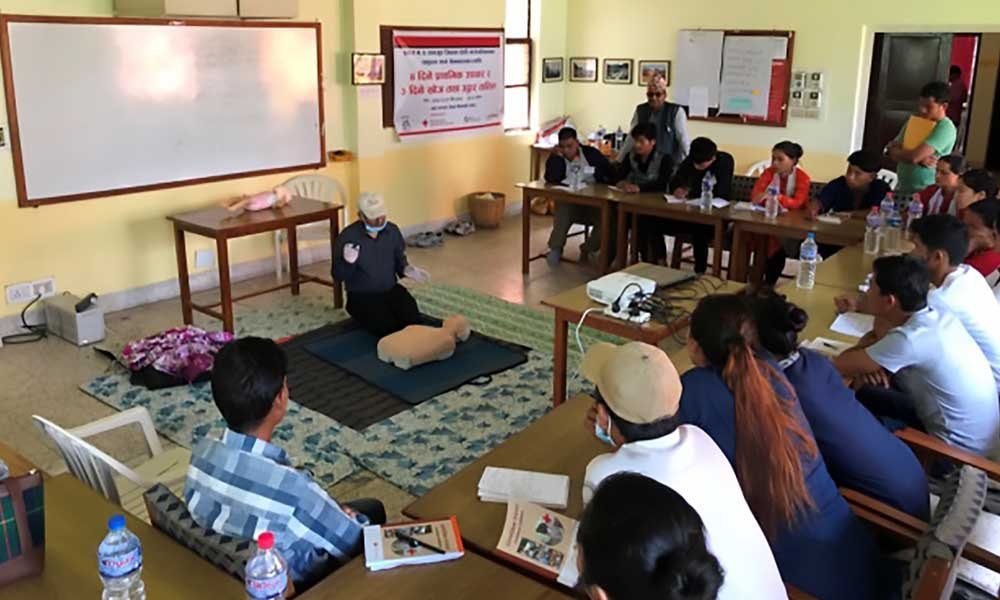 A trainer instructing the participants during the theory session of search and rescue training