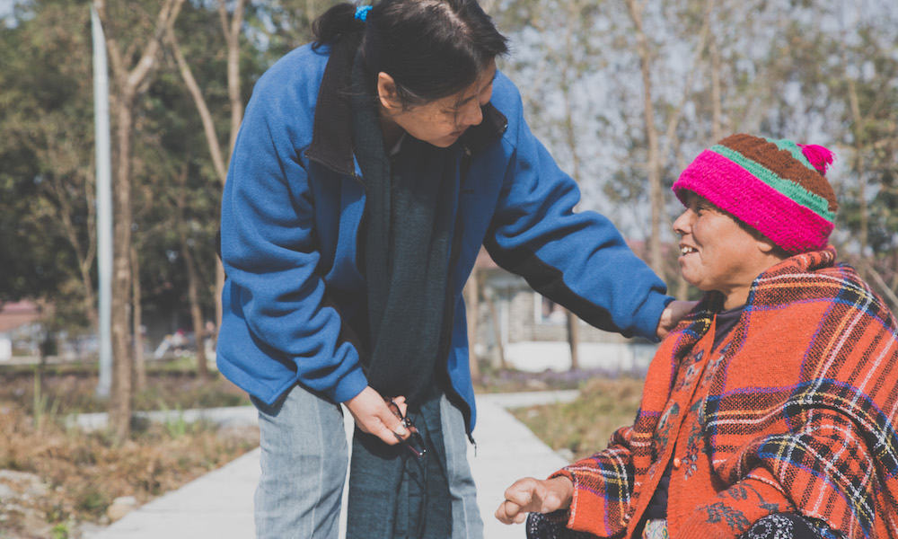 INF's Leprosy Nursing Advisor, Yuek Ming Poon, speaks to a leprosy patient